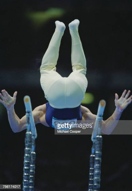 Ilia Giorgadze of Georgia performs his Parallel bars routine during the Men's artistic individual allaround competition of the XXVI Summer Olympic...