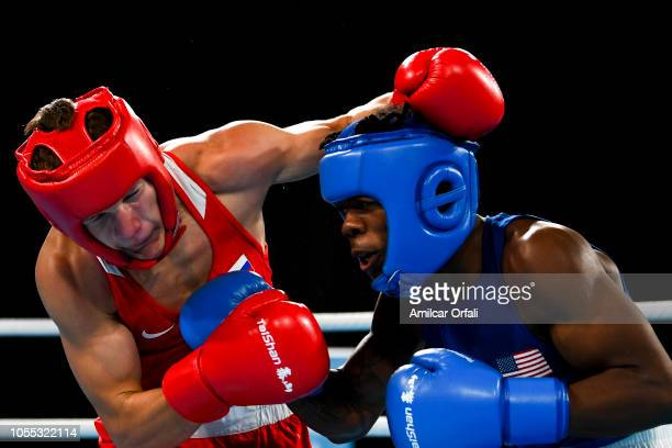 Ilia Popov of Russia and Otha Jones of United States compete in the Men's Light Welter Preliminary Round 2 on day 9 of Buenos Aires 2018 Youth...