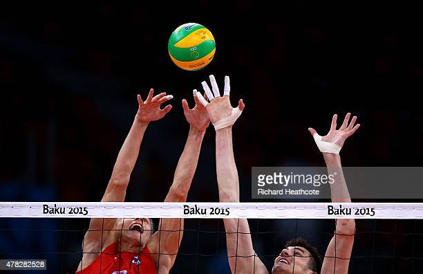 Ilia Vlasov and Dmitry Kovalev of Russia jump at the net during the Men's Volleyball quarter final match between France and Russia during day twelve...