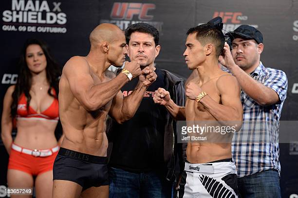 Iliarde Santos and Chris Cariaso face off during the UFC Fight Night: Maia v Shields weigh-in at the Ginasio Jose Correa on October 8, 2013 in...