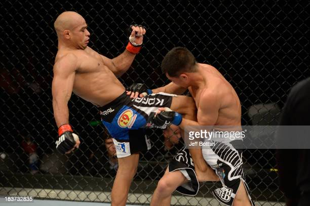 Iliarde Santos lands a knee to the torso of Chris Cariaso in their flyweight bout during the UFC Fight Night event at the Ginasio Jose Correa on...