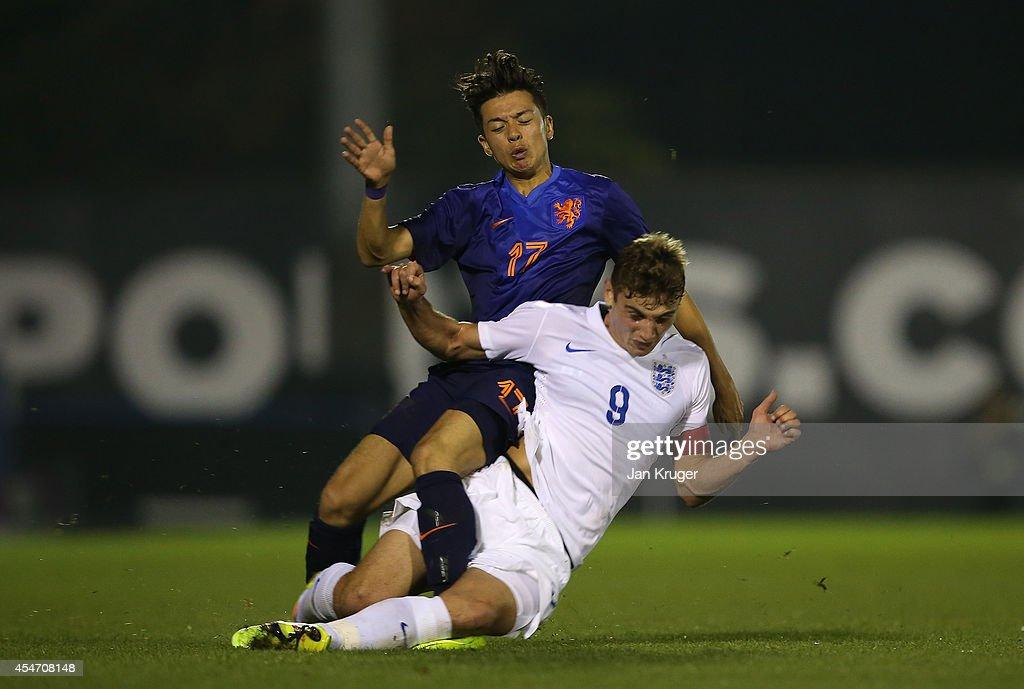 Ilias Alhaft of Netherlands U18 is tackled by Ryan Ledson of England U18 during the U18 International Friendly match between England U18 and Netherlands U18 at JD Stadium on September 5, 2014 in Bury, England.