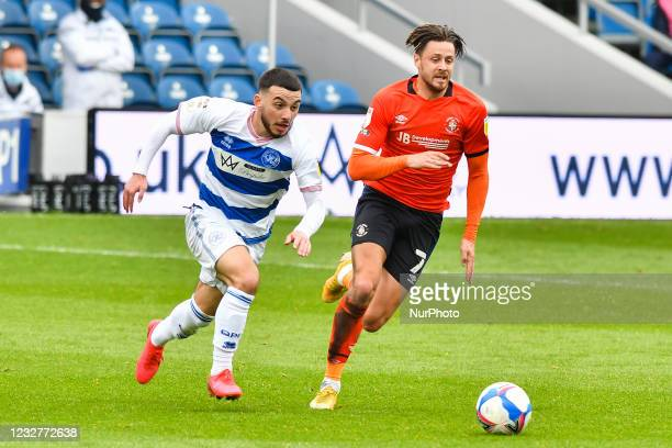 Ilias Chair of QPR battles for possession with Harry Cornick of Luton town during the Sky Bet Championship match between Queens Park Rangers and...