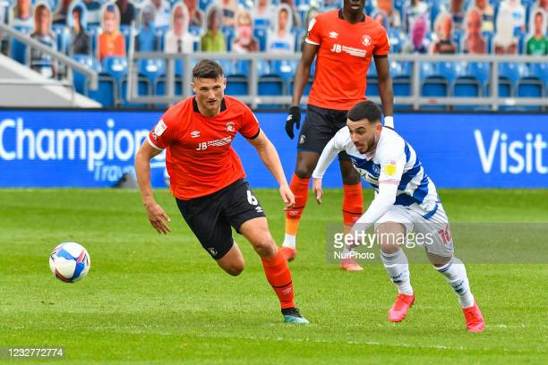Ilias Chair of QPR battles for possession with Matty Pearson of Luton town during the Sky Bet Championship match between Queens Park Rangers and...