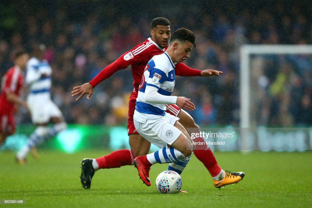 Ilias Chair of QPR tackles with David Davis of Birmingham City during the Sky Bet Championship match between Queens Park Rangers and Birmingham City at Loftus Road on April 28, 2018 in London, England.