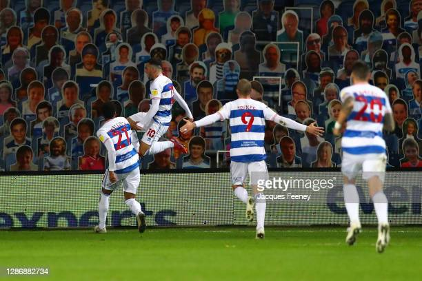 Ilias Chair of Queens Park Rangers celebrates with teammates Chris Willock and Lyndon Dykes after scoring his team's first goal during the Sky Bet...