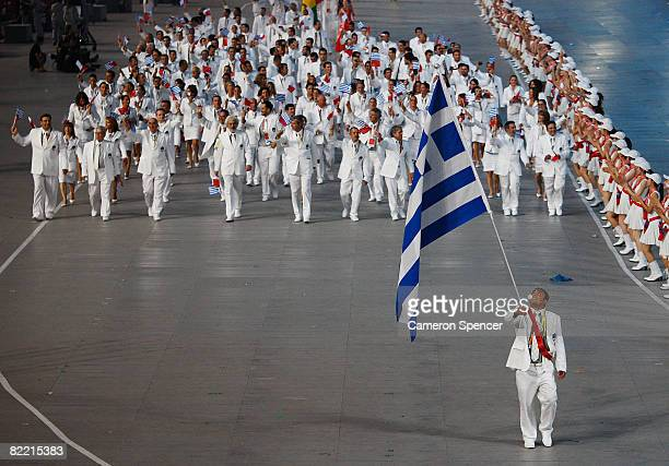 Ilias Iliadis of the Greece Olympic judo team carries his countries flag to lead out the delegation during the Opening Ceremony for the 2008 Beijing...
