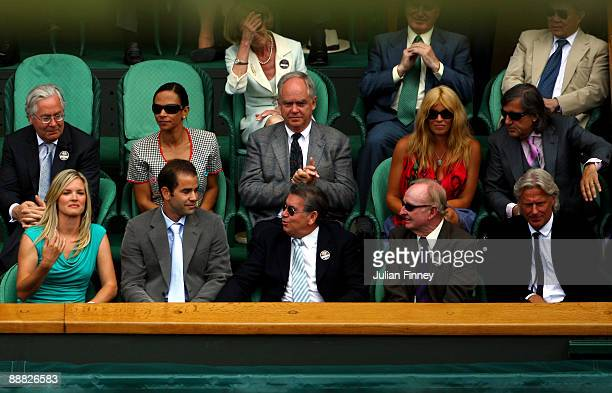 Ilie Nastase Bjorn Borg wife Patricia Rod Laver Manuel Santana Pete Sampras and wife Bridgette Wilson watch the action during the men's singles final...