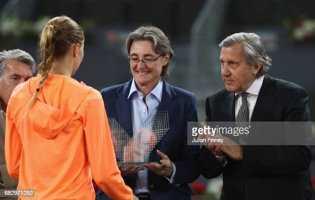 Ilie Nastase congratulates runner up Kristina Mladenovic of France after her loss to Simona Halep of Romania after the final during day eight at La...