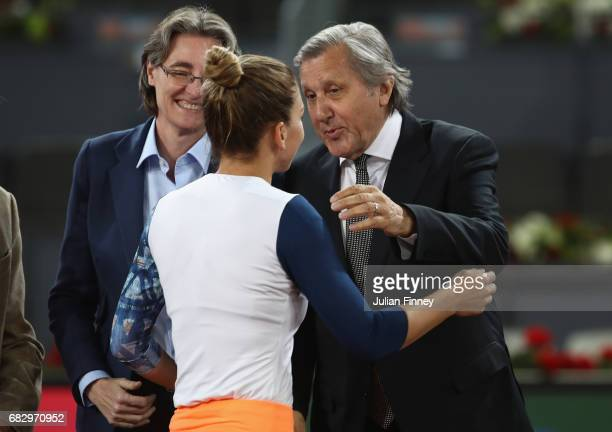 Ilie Nastase congratulates Simona Halep of Romania after her win over Kristina Mladenovic of France after the final during day eight at La Caja...