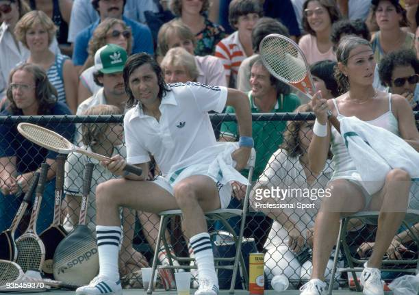 Ilie Nastase of Romania and Renee Richards of the USA taking a break during a Mixed Doubles match in the US Open at the USTA National Tennis Center...
