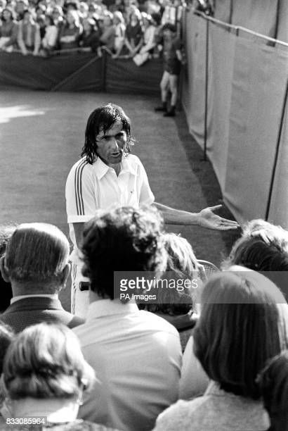 Ilie Nastase of Romania appeals to spectators who he complained were standing too close to the playing area on court two Number six seed Nastase who...