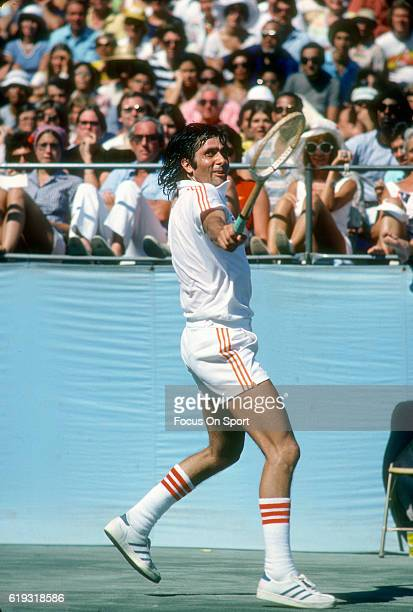 Ilie Nastase of Romania hits a return during a match in the Men's 1976 US Open Tennis Championships circa 1976 at the West Side Tennis Club in the...