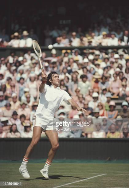 Ilie Nastase of Romania makes an overhead return against Bjorn Borg during their Men's Singles Final match at the Wimbledon Lawn Tennis Championship...