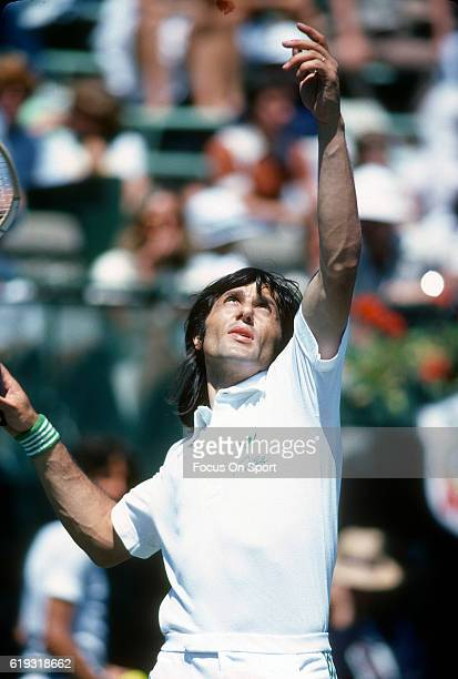 Ilie Nastase of Romania serves during a match in the Men's 1978 US Open Tennis Championships circa 1978 at the National Tennis Center in the Queens...