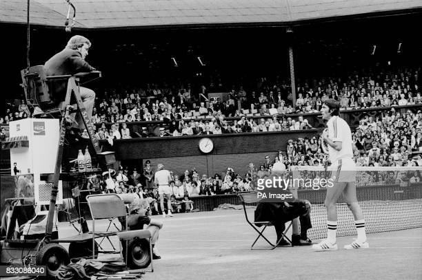 Ilie Nastase one set down to Sweden's Bjorn Borg takes time out to address the umpire during their men's singles quarter final match on Centre Court