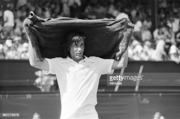 Ilie Nastase Romanian Tennis Player feels the heat at Wimbledon Tennis Championships temperatures of 104 degrees were registered on the Centre Court...