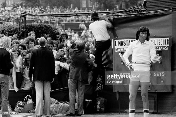 Ilie Nastase Romania's controversial tennis star waits as police and officials try to restore order on court 14 Spectators who filled the court an...