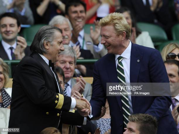 Ilie Nastase shakes hands with Boris Becker in the Royal Box during day six of the 2012 Wimbledon Championships at the All England Lawn Tennis Club...