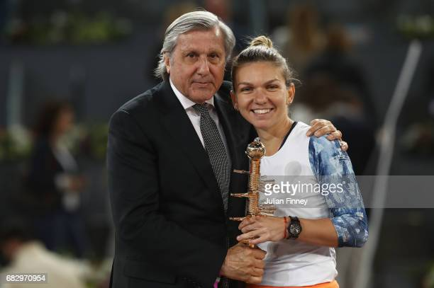 Ilie Nastase with Simona Halep of Romania after her win over Kristina Mladenovic of France after the final during day eight at La Caja Magica on May...