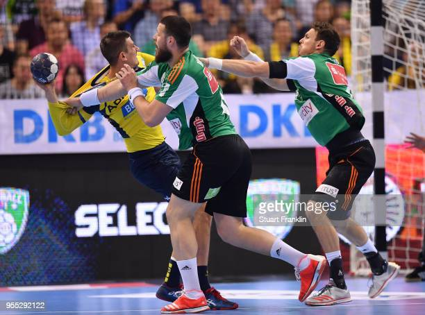Ilija Brozovi of Hannover challenges Alexander Petersson of RheinNeckar during the final of the DKB Handball Bundesliga Final Four between Hannover...