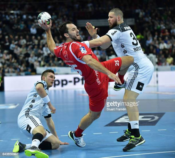 Ilija Brozovic of Kiel challenges Michael Mueller of Melsungen during the DKB Handball Bundesliga game between THW Kiel and MT Melsungen at...