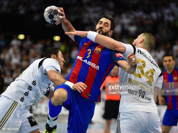 Ilija Brozovic of Kiel challenges Raul Rodriguez Entrerrios of Barcelona during the EHF Champions League Quarter Final first leg match between THW...