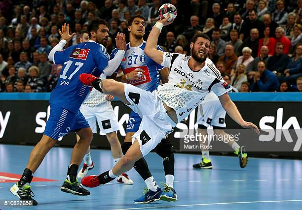 Ilija Brozovic of Kiel challenges Tiago Rocha of Plock for the ball during the VELUX EHF Champions League group A between THW Kiel and Orlen Wisla...