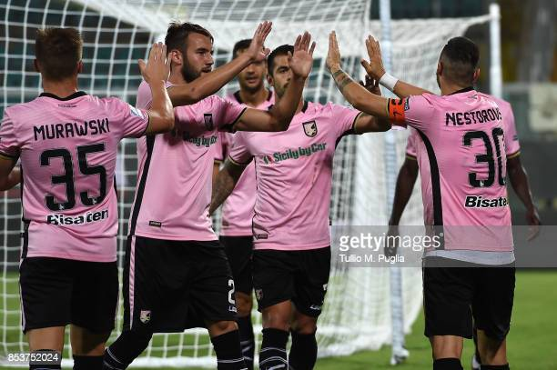 Ilija Nestorovski of Palermo celebrates with teammates after scoring his team's second goal during the Serie B match between US Citta di Palermo and...