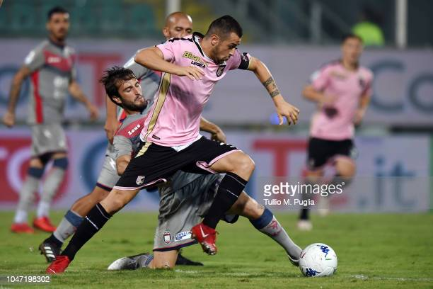 Ilija Nestorovski of Palermo is challenged by Andrea Barberis of Crotone during the Serie B match between US Citta' di Palermo and Crotone FC at...