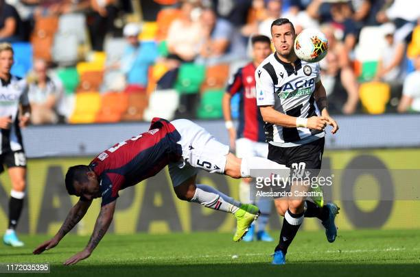 Ilija Nestorovski of Udinese Calcio competes for the ball with Gary Medel of Bologna FC during the Serie A match between Udinese Calcio and Bologna...