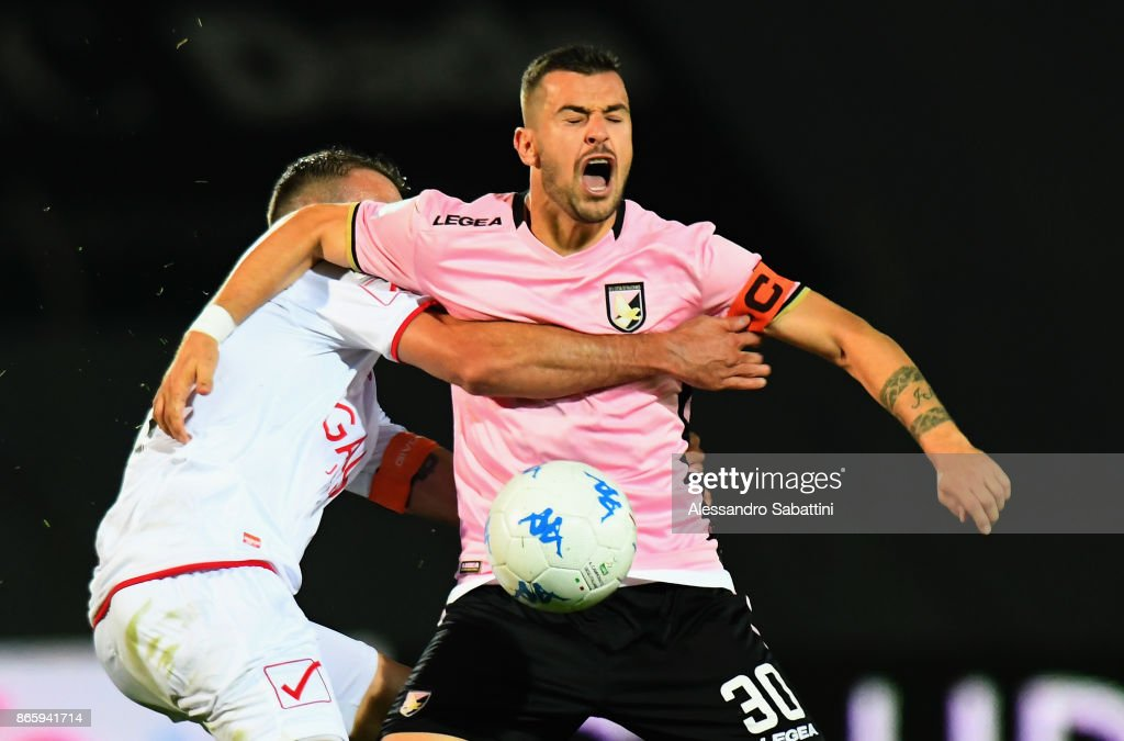 Ilija Nestorovski of US Citta di Palermo competes for the ball with Fabrizio Poli of FC Carpi during the Serie B match between FC Carpi and US Citta di Palermo on October 24, 2017 in Carpi, Italy.