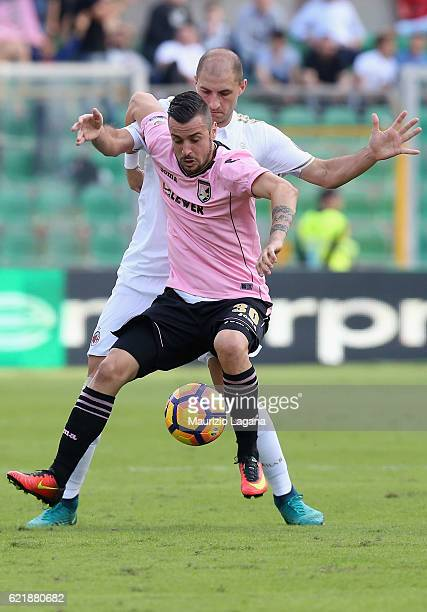 Ilija Nestorovsky of Palermo competes for the ball with Gabriel Paletta of Milan during the Serie A match between US Citta di Palermo and AC Milan at...