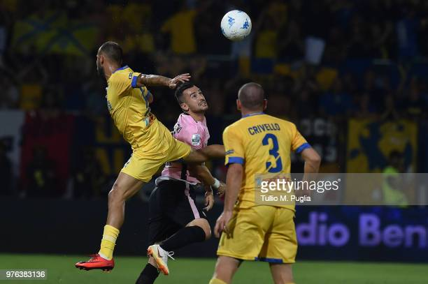 Ilija Nestorowski of Palermo is challenged by Federico Dionisi during the serie B playoff match final between Frosinone Calcio v US Citta di Palermo...