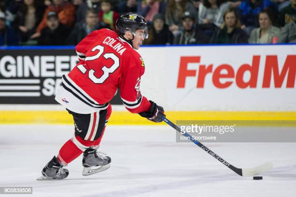 Ilijah Colina of the Portland Winterhawks skates the puck over the blue line during a game between the Everett Silvertips and the Portland...