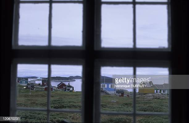 Ilimanaq village in Greenland The settlement of Ilimanaq which is situated just south of the Kangia Ice Fiord has a population of around 80 persons...