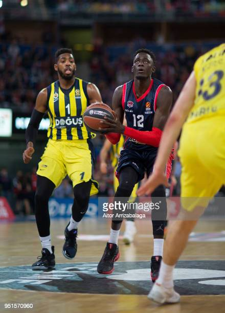 Ilimane Diop #12 of Kirolbet Baskonia Vitoria Gasteiz competes with Jason Thompson #1 of Fenerbahce Dogus Istanbul during the Turkish Airlines...