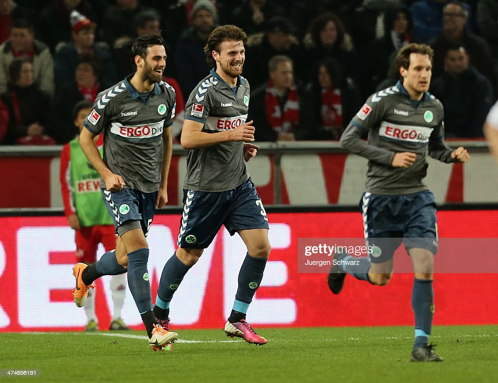 Ilir Azemi of Fuerth (C) smiles beside Mergim Mavraj (L) after scoring during the 2nd Bundesliga match between 1. FC Koeln and Greuther Fuerth at RheinEnergieStadion on February 24, 2014 in Cologne, Germany.