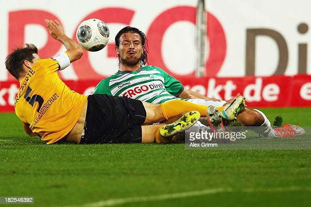 Ilir Azemi of Greuther Fuerth is challenged by Romain Bregerie of Dresden during the Bundesliga match between SpVgg Greuther Fuerth and Dynamo...