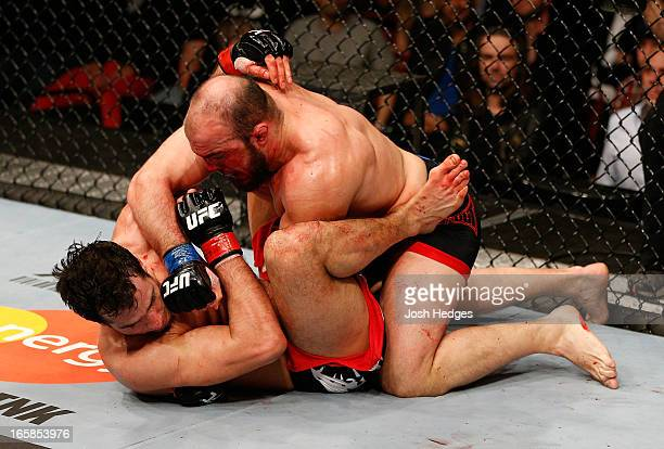 Ilir Latifi punches Gegard Mousasi in their light heavyweight fight at the Ericsson Globe Arena on April 6 2013 in Stockholm Sweden