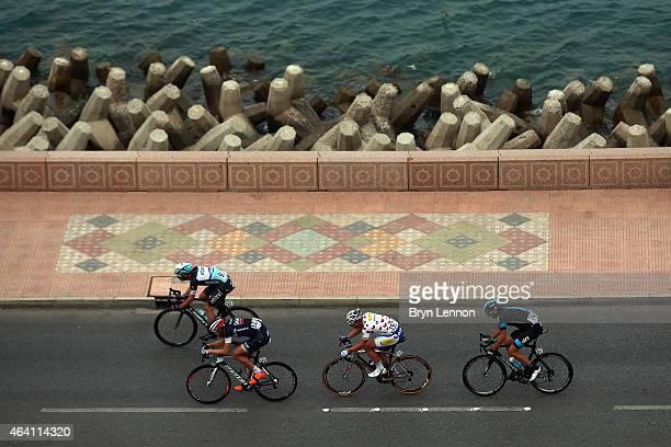 Iljo Keisse of Belgium and Etixx-QuickStep leads the breakaway group of Matthias Brandle of Austria and IAM Cycling, Jef Van Meirhaeghe of Belgium...