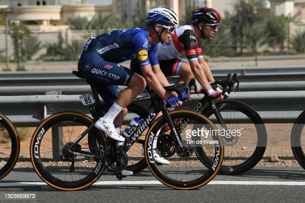 Iljo Keisse of Belgium and Team Deceuninck - Quick-Step & Maximiliano Richeze of Argentina and UAE Team Emirates during the 3rd UAE Tour 2021, Stage...