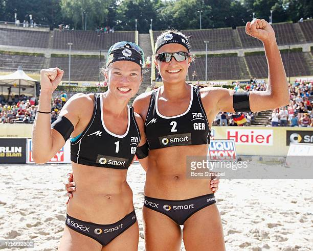 Ilka Semmler and Katrin Holtwick of Germany pose after winning a match between Germany and USA on day six of the Berlin Smart Grand Slam of FIVB...