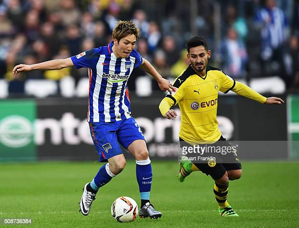 Ilkay Gündogan of Dortmund is challenged by Genki Haraguchi of Berlin during the Bundesliga match bewteen Hertha BSC and Borussia Dortmund at...