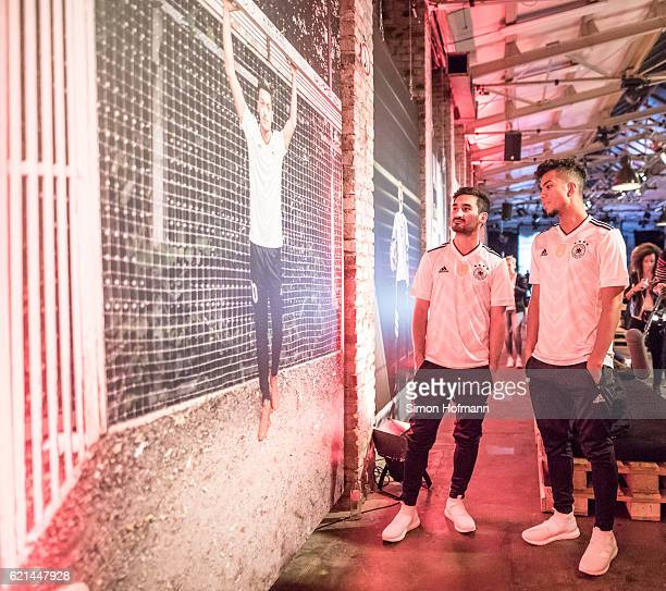 Ilkay Guendogan and Benjamin Henrichs attend the ADIDAS presentation of the new DFB home jersey for the FIFA Confederations Cup at Boui Boui Bilk on...