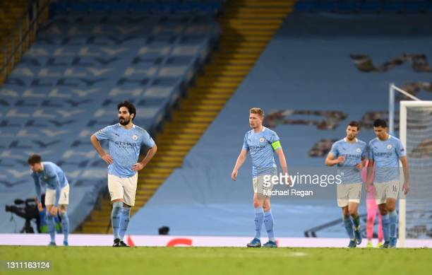 Ilkay Guendogan and Kevin De Bruyne of Manchester City react after conceding their first goal during the UEFA Champions League Quarter Final match...
