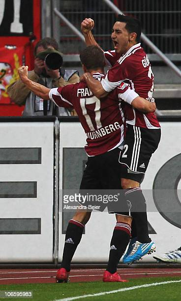 Ilkay Guendogan and Mike Frantz of Nuernberg celebrate Guendogan's first goal during the German Bundesliga match between 1 FC Nuernberg and 1 FC...