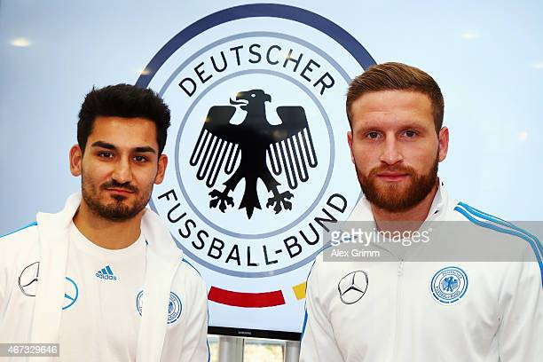 Ilkay Guendogan and Shkodran Mustafi pose after a Germany press conference at the DFB headquarters on March 23 2015 in Kaiserslautern Germany