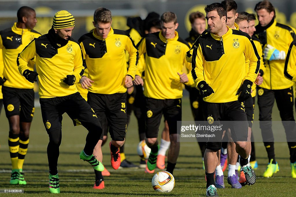 Ilkay Guendogan and Sokratis attend the Borussia Dortmund training session prior to the UEFA Europa League match between Borussia Dortmund and Tottenham Hotspur FC at Signal Iduna Park on March 9, 2016 in Dortmund, Germany.