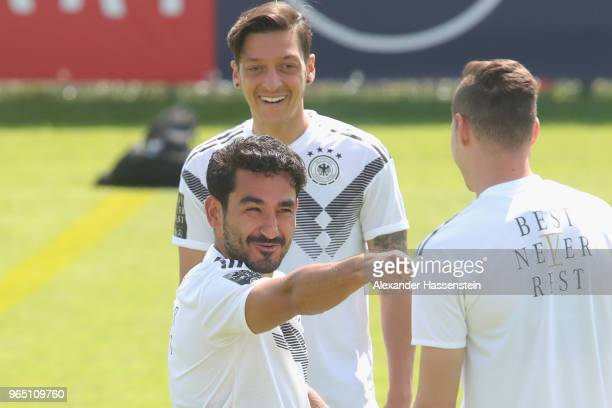 Ilkay Guendogan jokes with team mate Julian Draxler during a training session of the German national team at Sportanlage Rungg on day ten of the...